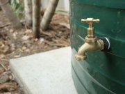Garden tap on rainwater tank for filling buckets without using electricity.