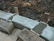 Concreting gaps between the re-arranged curbing.
